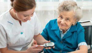 Female performs nursing services Calgary for a senior woman